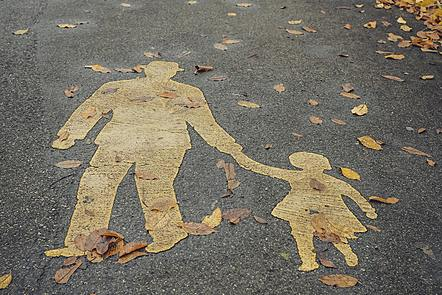 Picture of man and girl hold hands on pavements