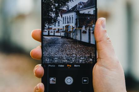 A photo being taken through a mobile phone, Frederic Paulussen, Unsplash