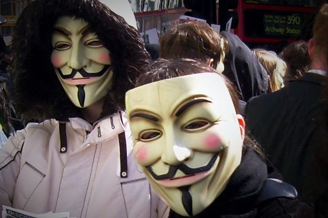 Activists in Guy Fawkes masks.