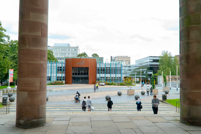 Students walking in the quad at Coventry University