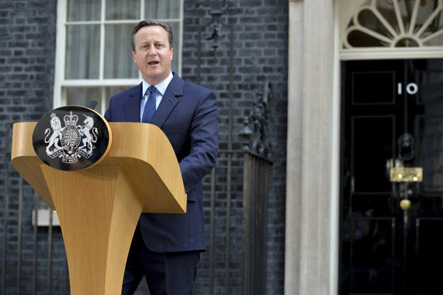 UK Prime Minister David Cameron standing at a podium in Downing Street giving a speech