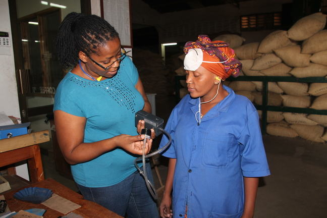 Here, an occupational hygienist visits a coffee factory, where she is going to do personal dust measurements.