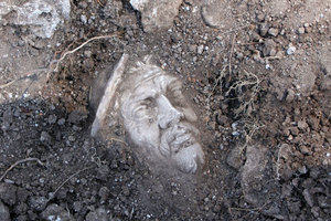 A marble head revealed in the earth as an archaeological find at Portus