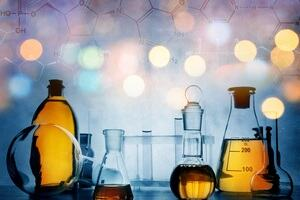 a picture of lab equipment and chemical solutions, overlaid with chemical compound structures
