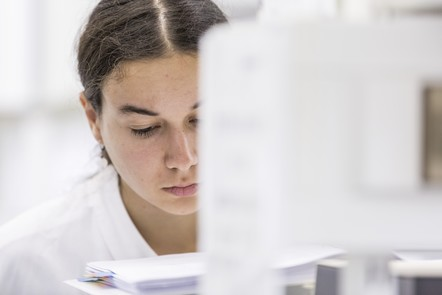 Learner in the lab looking pensive