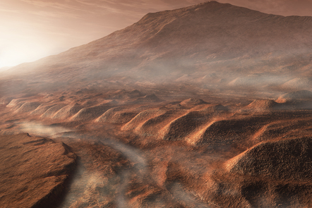 A light fog forms in a desiccated gully in Gale Crater, Mars. The crater's 5km high central mound can be seen in the background.