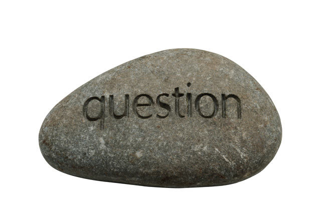 The word 'question' carved into a large stone