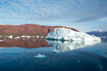 Photo of mountains and an iceberg in a body of water