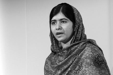 Black and white photograph of Malala Yousafzai making a speech.
