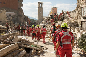 Emergency workers clearing the damage after an earthquake