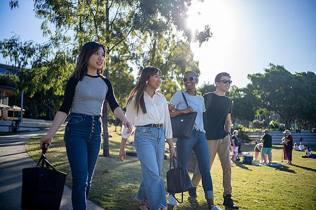 4 students walk in an Australian park