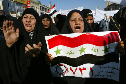Iraqis attend a parliamentary election fraud protest.