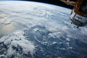 Image of the earth and satellite in space