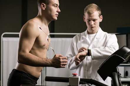 Athlete being monitored by healthcare professional.