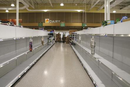 1 supermarket alley with empty shelves