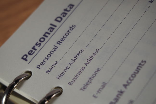 Ring binder with personal data highlighted.