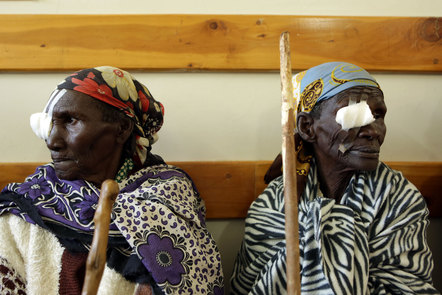 Two patients wait to have their bandages removed after cataract surgery. Image credit: © Peek Vision
