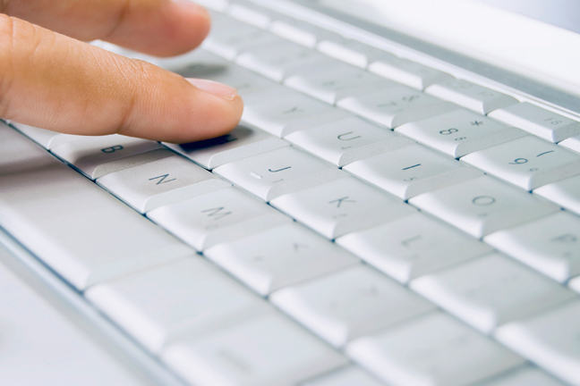 Person using computer keyboard.