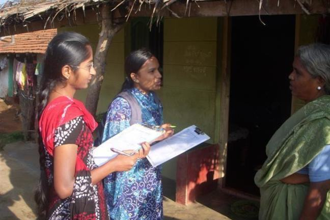 Image of two women conducting a survey at a medical camp.