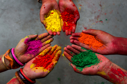 A scene from the Holi festival in India. Outstretched hands hold the coloured powder that forms part of the celebrations.