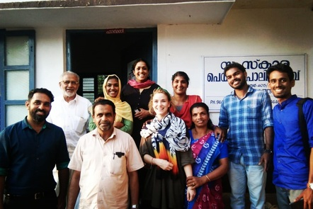 Group of volunteers from Kerala, standing together outside of a hospice