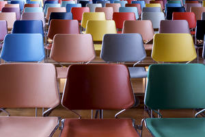 Rows of multicolour chairs