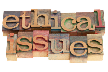 Ethical issues words in vintage wood letterpress printing blocks, isolated on white.