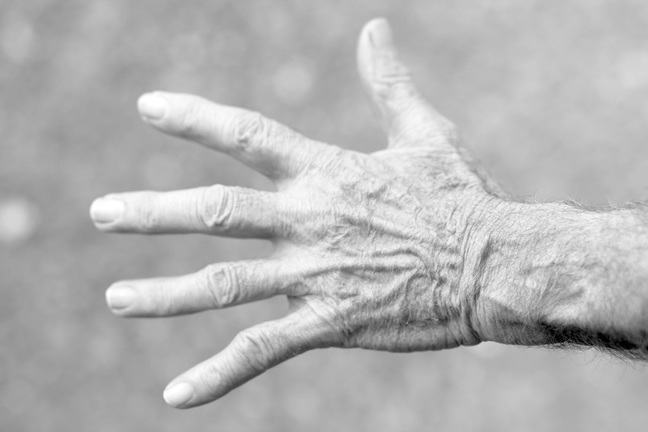 An elderly person's hand