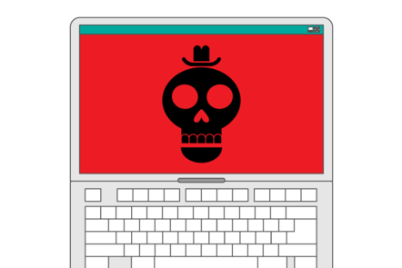 A laptop with a skull showing on the screen