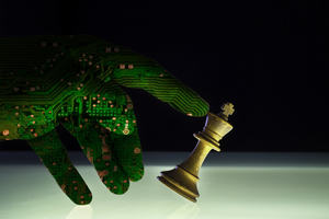 Computer artificial intelligence hand concept of check mate against a white king chess piece. AI technology brain of a robot arm supersedes human power.
