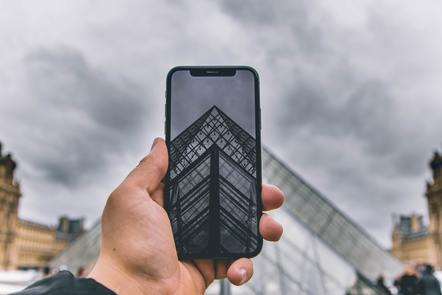 Someone taking a photo of the Louvre museum on their smartphone, Harrison Moore, Unsplash
