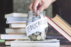 Jar containing money that says education