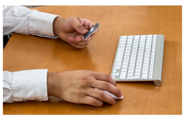 Man entering credit card details online