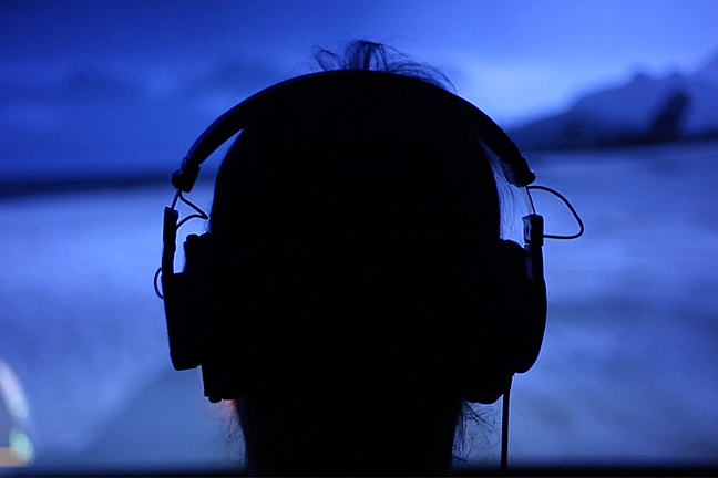 Sillhouette of person playing a game wearing a headset