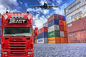 Photo of a plane, lorry and shipping containers