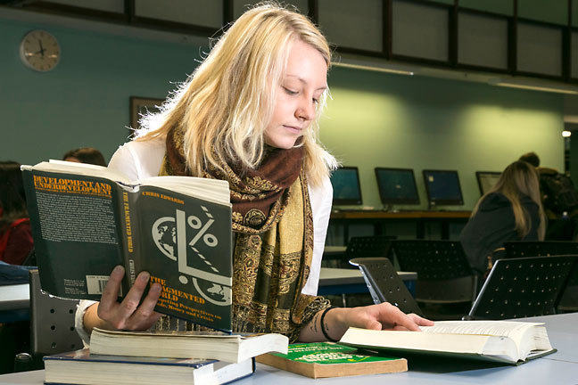 A student consulting various books