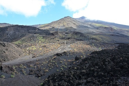 The rocky, black ash-laden slopes that lead up to the summit of Mount Etna