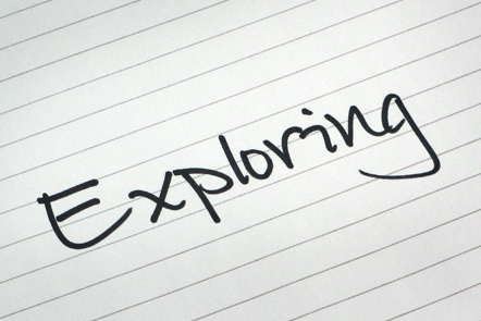 A page with the word 'Exploring' written down.