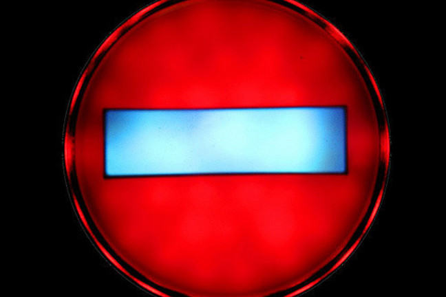 Red circular light with blue bar in the centre: illuminated stop sign