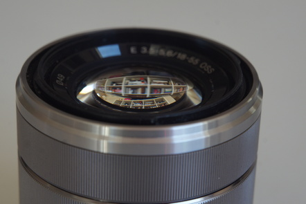 image of a camera lens with reflection (Petri Krohn)