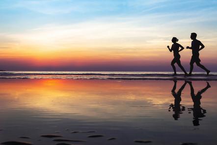 A couple running on a beach