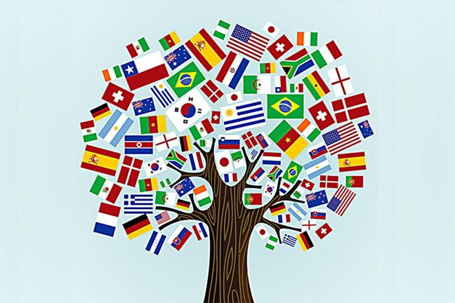 Tree decorated with flags of lots of different countries.