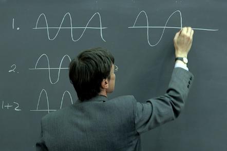Educator Richard Ball drawing waves on a blackboard