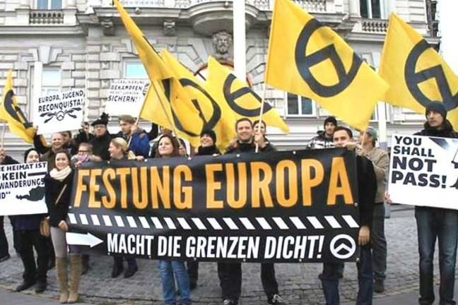 Far-right activists from the Festung Europa (Fortress Europe) movement at a Identitarian Movement of Austria rally in Vienna on November 10, 2013