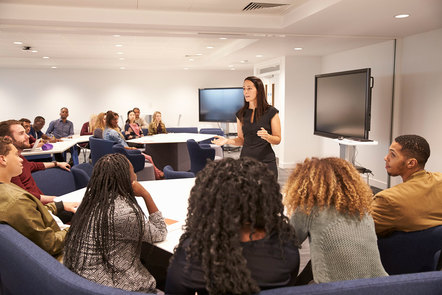 A female presenter leading a study group