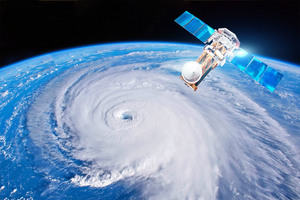 Image of Satellite above the Earth. There is a hurricane eye visible on Earth.