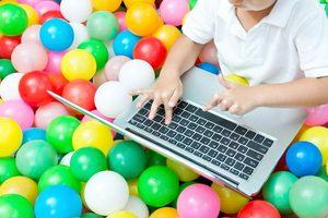Childhood in the Digital Age - a child using a laptop