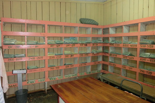A room with shelves and files in an archive system