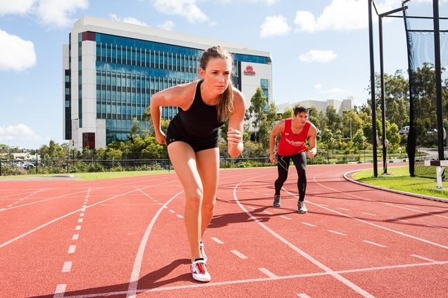 Two runners on the Griffith University athletics track