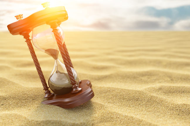 Hourglass sitting in a desert